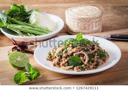 辛い 豚肉 サラダ 黒 プレート 肉 ストックフォト © eddows_arunothai