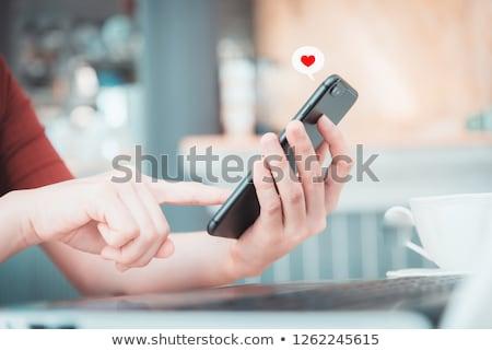 çift sevmek teknoloji gülen Stok fotoğraf © imagedb