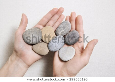 handful of stones in hands stock photo © paha_l