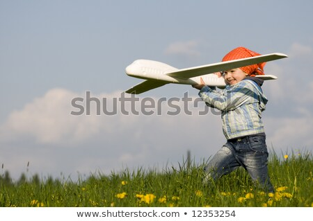 little girl with toy airplane in hands outdoor stock photo © paha_l