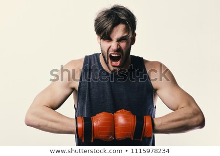sport man wearing boxing gloves on the white stock photo © vlad_star