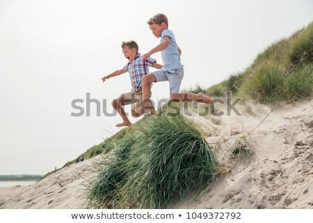 Widok z boku chłopca gry piasku plaży charakter Zdjęcia stock © wavebreak_media