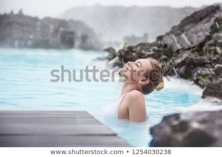 Girl relaxing in geothermal pool outdoors stock photo © bezikus