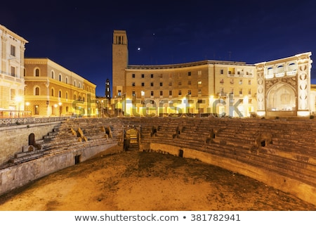 Roman Amphitheatre in Piazza Santo Oronzo square. Lecce, Italy. Stock photo © Photooiasson