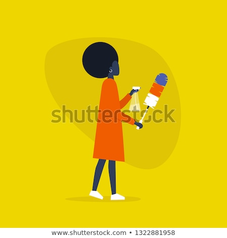 African housemaid holding spray bottle and duster. Stock photo © RAStudio