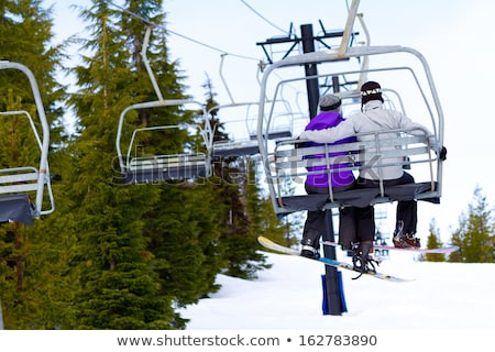 Couple sitting close in chair lift Stock photo © IS2
