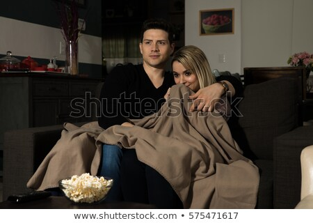 Couple Huddled in Blanket Stock photo © IS2