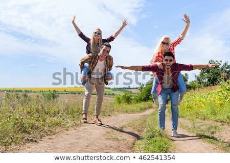 group of young people riding piggy back Stock photo © IS2