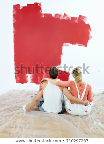Couple contemplating painted wall Stock photo © IS2