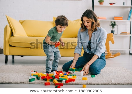 mother and son play with building blocks Stock photo © IS2