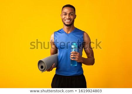 Férfi tart testmozgás középső rész fitnessz kék Stock fotó © wavebreak_media