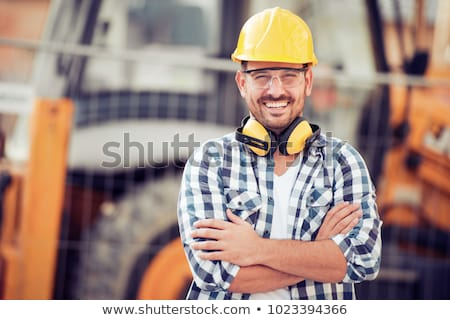 portrait of young man working in construction site stock photo © diego_cervo