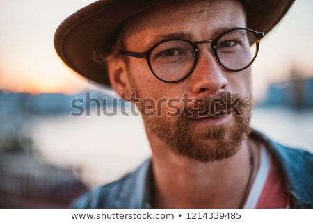 man with beard on city street Stock photo © dolgachov