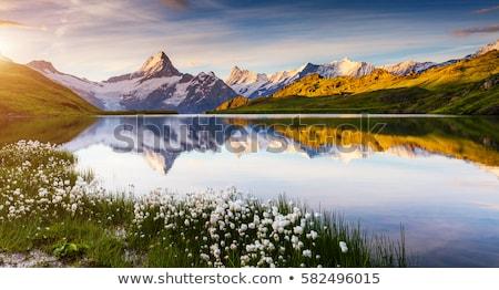 Stock fotó: Tavasz · tájkép · hegy · tó · nap · felhők