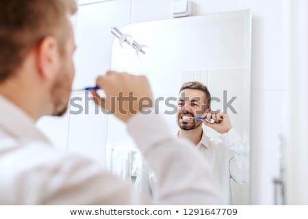 Jeune homme salle de bain maison heureux dents Photo stock © galitskaya