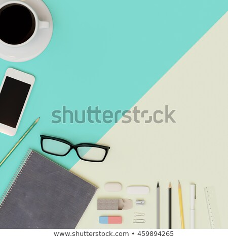 Smartphone on green notebook and pen with eyeglasses on copybook Stock photo © pressmaster