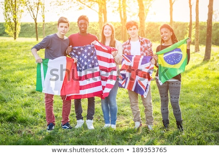 happy friends with flags of different countries stock photo © dolgachov