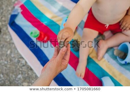Boy giving mom stone Stock photo © galitskaya