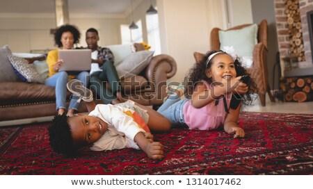 Oldalnézet boldog afroamerikai testvér padló tv nézés Stock fotó © wavebreak_media