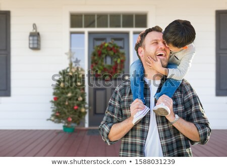 Young Mixed Race Boy On Front Porch of House with Christmas Deco Stock photo © feverpitch
