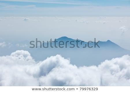 Bergen wolken zonsondergang hemel landschap berg Stockfoto © dmitry_rukhlenko