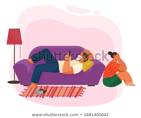 Guy Lie on Sofa and Play on Phone, Living Room Stock photo © robuart