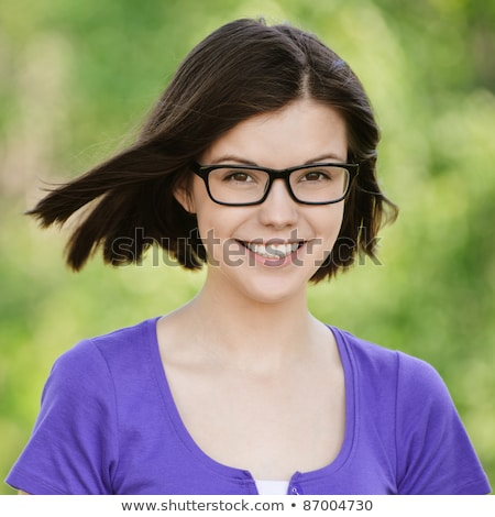 young girl in violet blouse and spectacles stock photo © ruslanomega