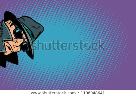 man in a black coat and hat stock photo © ruslanomega