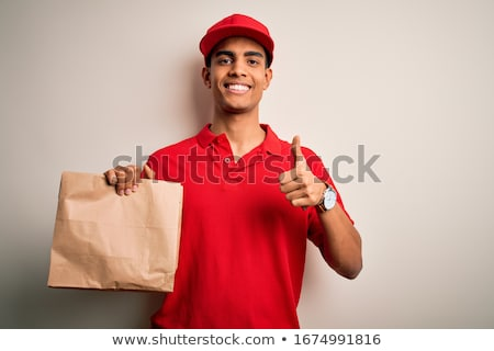 delivery man holding packages and doing the okay sign Stock photo © photography33