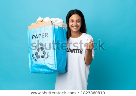 Woman making money by recycling Stock photo © photography33