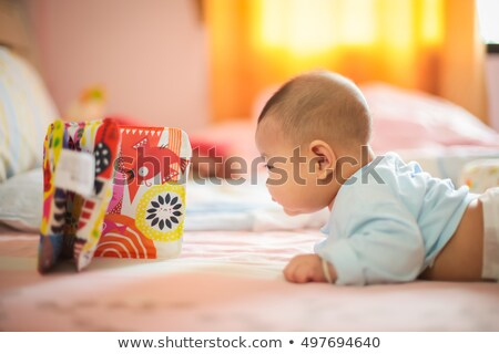 Isolated curious pretty girl child crawling Stock photo © stockyimages