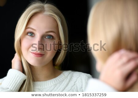 Portrait of the young blonde near a mirror stock photo © acidgrey