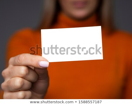 attractive student with business card stock photo © dolgachov