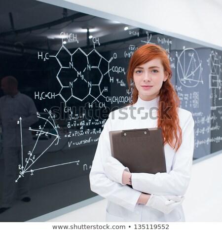 gülen · kadın · bilim · adamı · bakıyor · kamera - stok fotoğraf © wavebreak_media