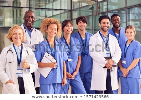 Medical team of Doctors and male nurse stock photo © get4net
