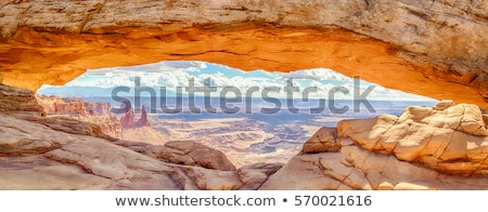 panoramic view of sunrise at mesa arch stock photo © vwalakte
