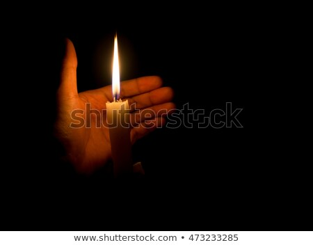 Hands guarding a candlelight Stock photo © snyfer