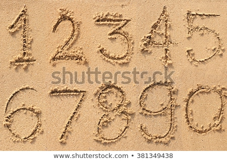 Numbering On Sand Stock photo © cosma