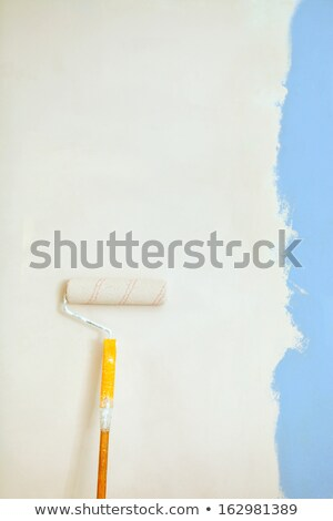 Roller brush with orange grip against wall. Stock photo © luckyraccoon
