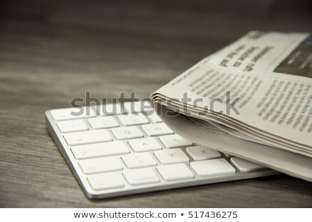 Stock photo: stack of newspapers and keyboard
