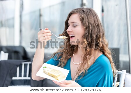 side of a smiling elegant woman in golden dress Stock photo © feedough