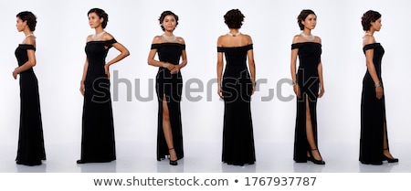Portrait of attractive woman in black dress over white background Stock photo © deandrobot