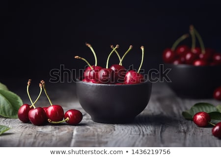 Sweet Cherry in Bowl on Rustic Table Stock photo © stevanovicigor