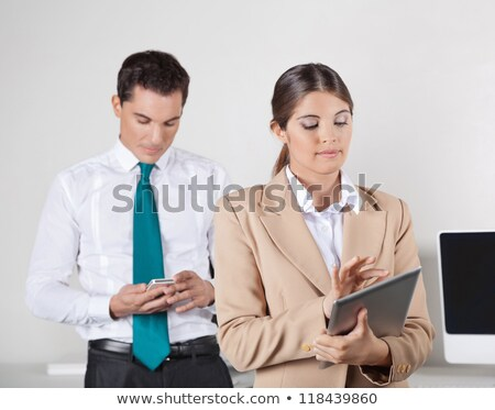 Stock photo: two businesspeople with smartphone and tablet pc