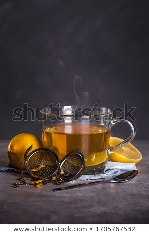Cup of hot tea on a dark blue napkin Stock photo © Tatik22