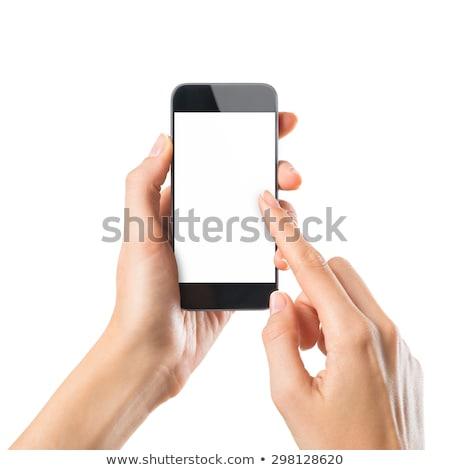 Smart phone in a woman's hand Stock photo © punsayaporn
