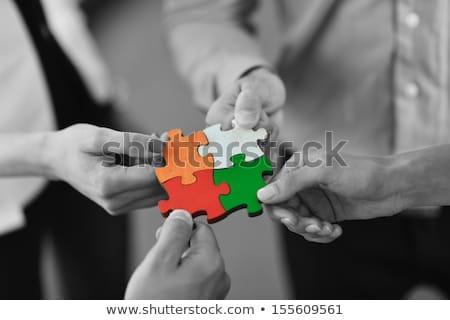Рука держит красный кусок головоломки Сток-фото © dotshock