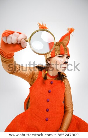 Young woman in image of squirrel with magnifying glass Stock photo © master1305