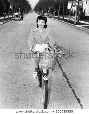 Kadın bağbozumu bisiklet sokak genç Stok fotoğraf © dariazu