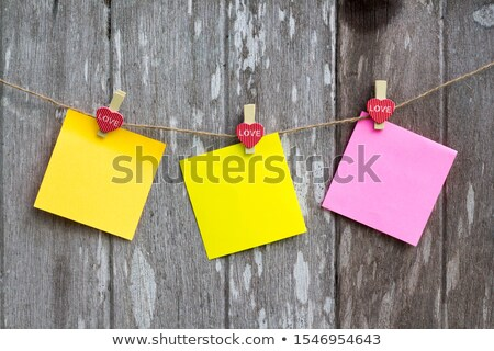 Blank orange note pad sheets hanging from string Stock photo © ozgur
